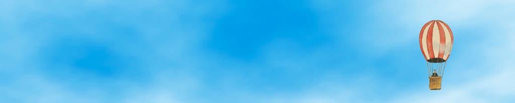 De directeur in een luchtballon, nog met het hoofd in de wolken